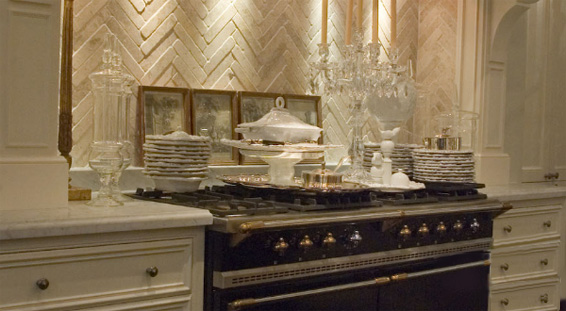 de Portier French kitchen Lacanche Range and limestone herringbone pattern backsplash